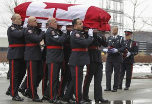 A Toronto Police ceremonial guard outside the Toronto Congress Centre carry the casket of Toronto Police Constable John Zivcic,, who died in the line of duty while responding to an impaired driver call.